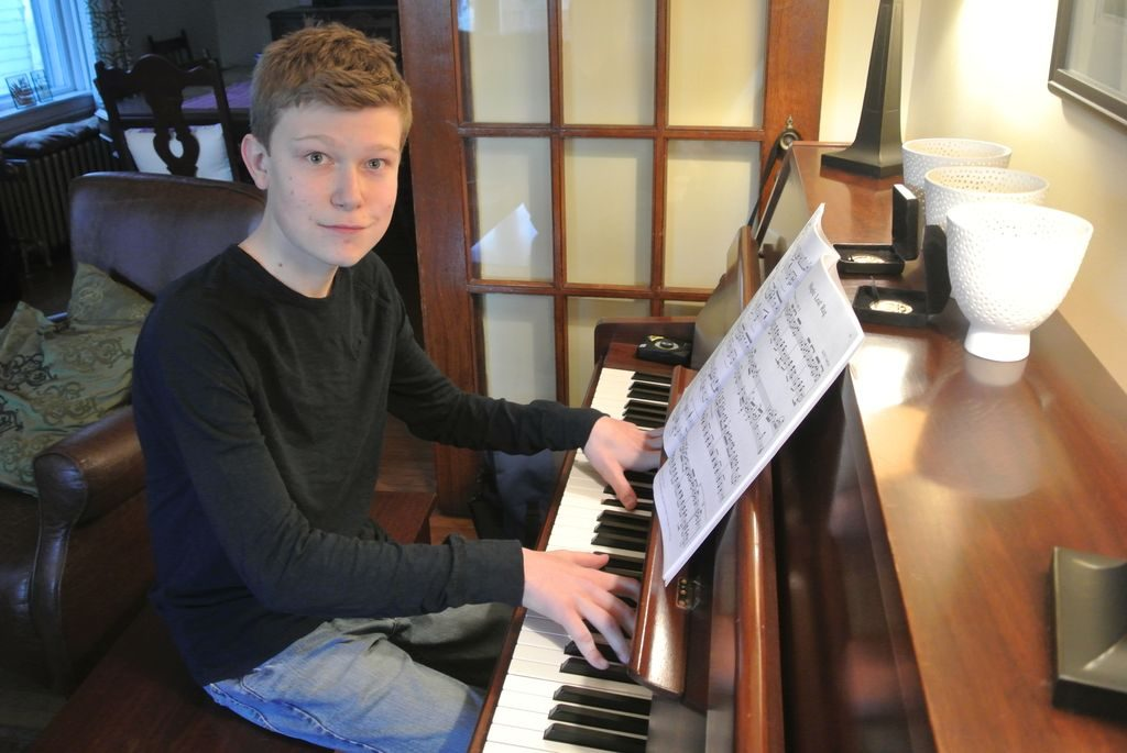 Teenager plays the piano